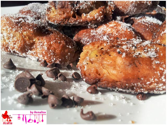 Friedcakes with chocolate drops close